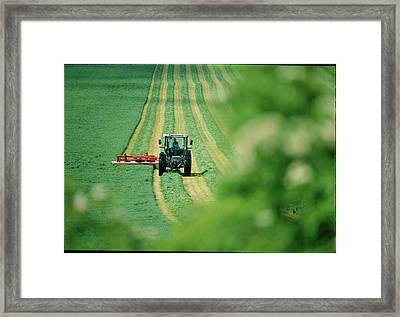 Tractor Cutting Grass Framed Print by Jeremy Walker