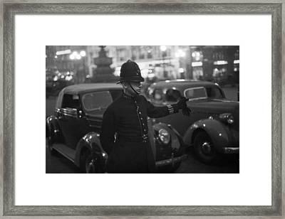 Traffic Cop Framed Print by Kurt Hutton