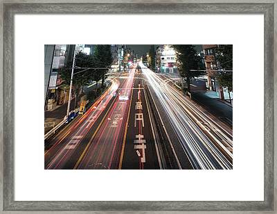 Traffic Trails At Night, Tokyo Framed Print by Spiraldelight