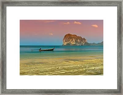 Trang Longboat Framed Print by Adrian Evans