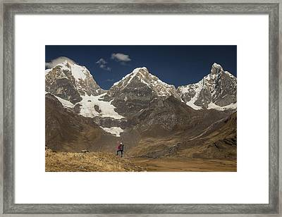 Trekker Beneath Yerupaja  The Yerupaja Framed Print by Colin Monteath