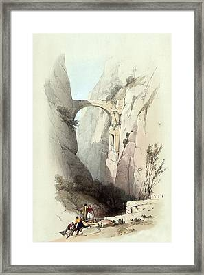 Triumphal Arch Across The Ravine Leading To Petra Framed Print by Munir Alawi
