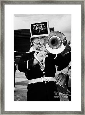 trombone player of the band of HM Royal Marines Scotland at Armed Forces Day 2010 Framed Print by Joe Fox