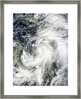 Tropical Storm Sandy Hovering Framed Print by Stocktrek Images