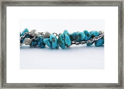 Turquoise Stones And Silver Chain Framed Print by Blink Images