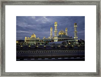 Twilight View Of An Illuminated Mosque Framed Print by Paul Chesley