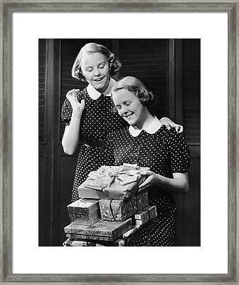 Twin Teenage Girls W/ Wrapped Gifts Framed Print by George Marks