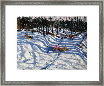 Two Boys Falling Off A Sledge Framed Print by Andrew Macara