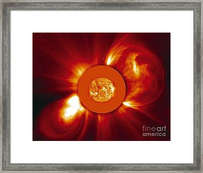 Two Coronal Mass Ejections Framed Print by Solar & Heliospheric Observatory consortium (ESA & NASA)