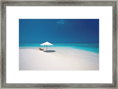 Two Deck Chairs And Beach Umbrella On Tropical Bea Framed Print by Sakis Papadopoulos