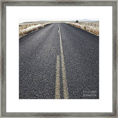 Two Lane Road Between Fenced Fields Framed Print by Jetta Productions, Inc