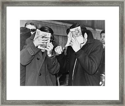 Two New York City Students Covering Framed Print by Everett