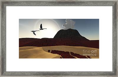 Two Swans Fly Over Cooling Lava Flows Framed Print by Corey Ford