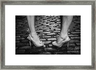 Two Young Women Wearing High Heeled Shoes And Fake Tan On Cobblestones On A Night Out Framed Print by Joe Fox