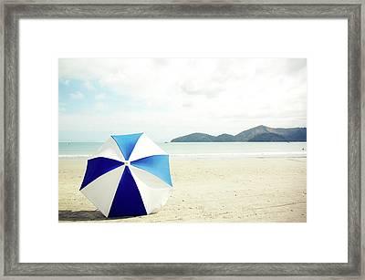Umbrella On Sand Framed Print by Grace Oda