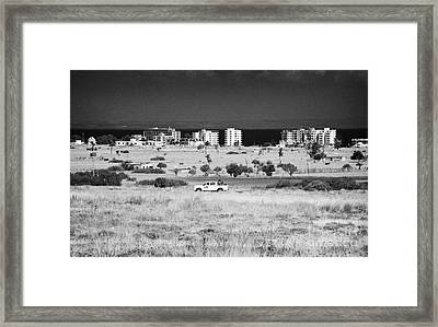 Un Border Patrol Driving Through The Heat Haze In The Un Buffer Zone In The Green Line Famagusta Framed Print by Joe Fox