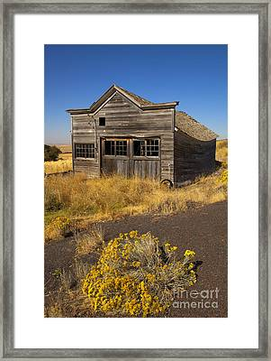 Under The Weight Of It All Framed Print by Mike  Dawson