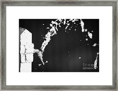 Upside Down Faucet Spraying Water Framed Print by Joe Fox