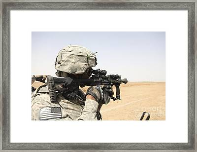 U.s. Army Soldier Scans The Horizon Framed Print by Stocktrek Images