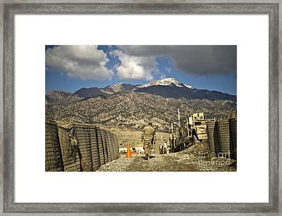 U.s. Army Soldier Walks Down A Path Framed Print by Stocktrek Images