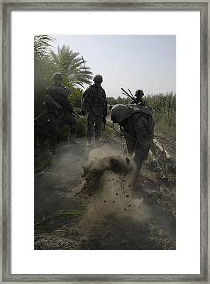 Us Army Soldiers Search For Buried Framed Print by Everett