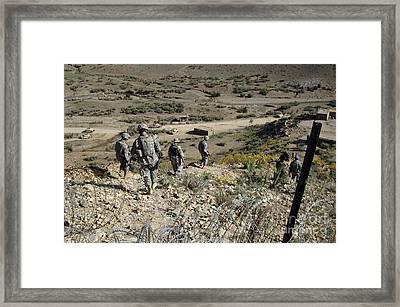 U.s Army Soldiers Walk Back Framed Print by Stocktrek Images