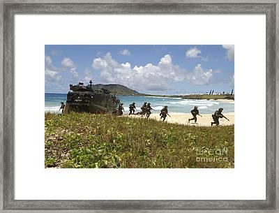 U.s. Marines Run Out Of An Amphibious Framed Print by Stocktrek Images