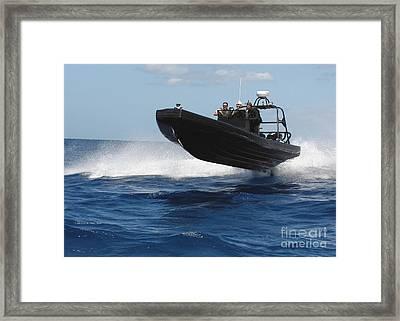 U.s. Navy Sailors Operate A Nine-meter Framed Print by Stocktrek Images