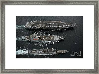 U.s. Navy Ships Conduct A Replenishment Framed Print by Stocktrek Images
