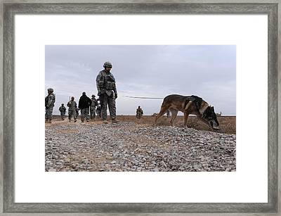 Us Soldier And His Working Dog Search Framed Print by Everett