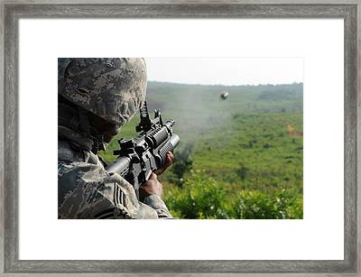 Us Soldier Fires A Practice Round Framed Print by Everett