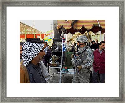 Us Soldier Patrols The Streets Framed Print by Everett
