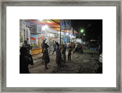 Us Soldiers On A Busy Night Framed Print by Everett
