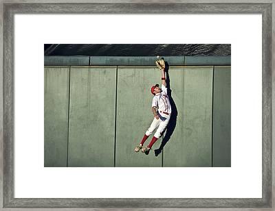 Usa, California, San Bernardino, Baseball Player Making Leaping Catch At Wall Framed Print by Donald Miralle