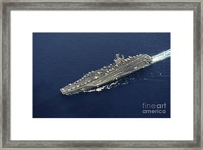 Uss Abraham Lincoln Transits The Indian Framed Print by Stocktrek Images
