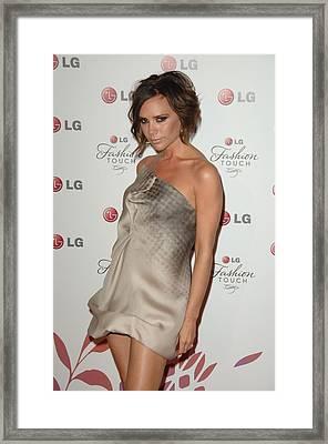 Victoria Beckham Wearing A Victoria Framed Print by Everett