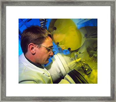 View Of A Light-emitting Polymer Researcher Framed Print by David Parker