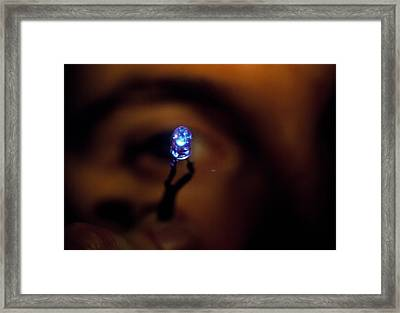View Of A Man Holding A Blue Light Emitting Diode Framed Print by Volker Steger