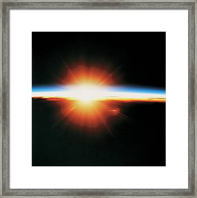 View Of The Sunrise From Space Framed Print by Stockbyte