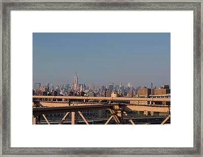 View Over New York City From Brooklyn Bridge Framed Print by Thepurpledoor