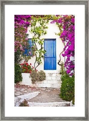 Village In Greece Framed Print by Tom Gowanlock