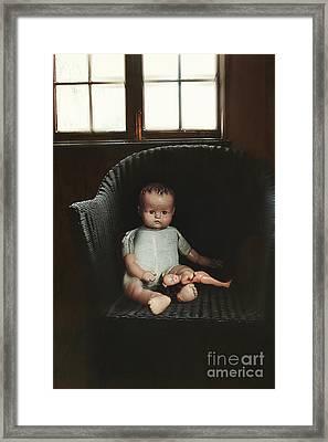 Vintage Dolls On Chair In Dark Room Framed Print by Sandra Cunningham