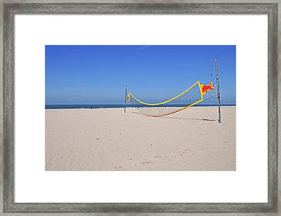 Volleyball Net On Beach Framed Print by Leuntje