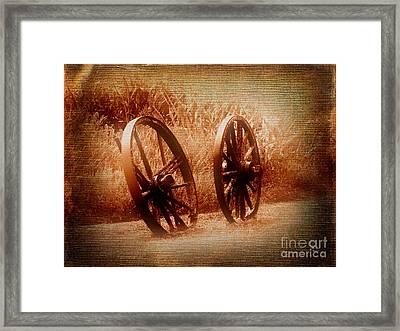 Wagon Wheels Framed Print by Ms Judi