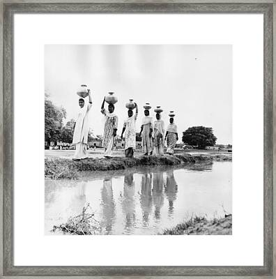 Water Carriers Framed Print by Three Lions