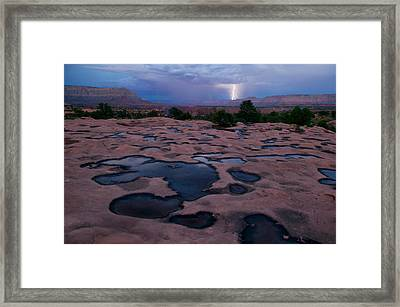 Water Puddled In The Esplanade, A Rock Framed Print by Michael Nichols