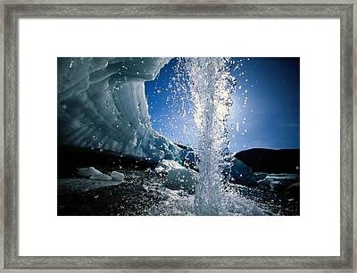 Water Splashes Over A Sheet Of Ice Framed Print by Raymond Gehman