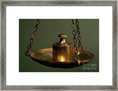 Weights On Scale Framed Print by Sami Sarkis