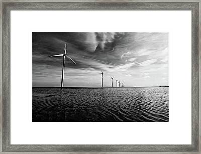 Windmills Out At Sea Framed Print by Kenneth McNeil