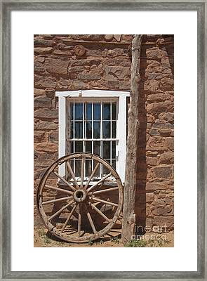 Window In Stone Building With Wagon Wheel Framed Print by Thom Gourley/Flatbread Images, LLC